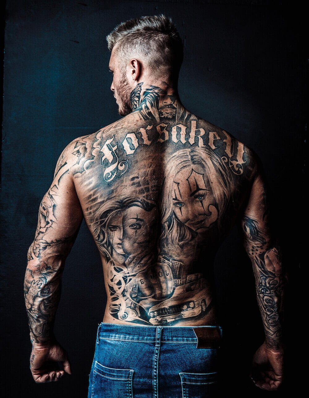 Male Stripper Back Tattoo